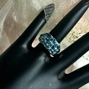 STERLING SILVER AND BLUE TOPAZ BAND RING